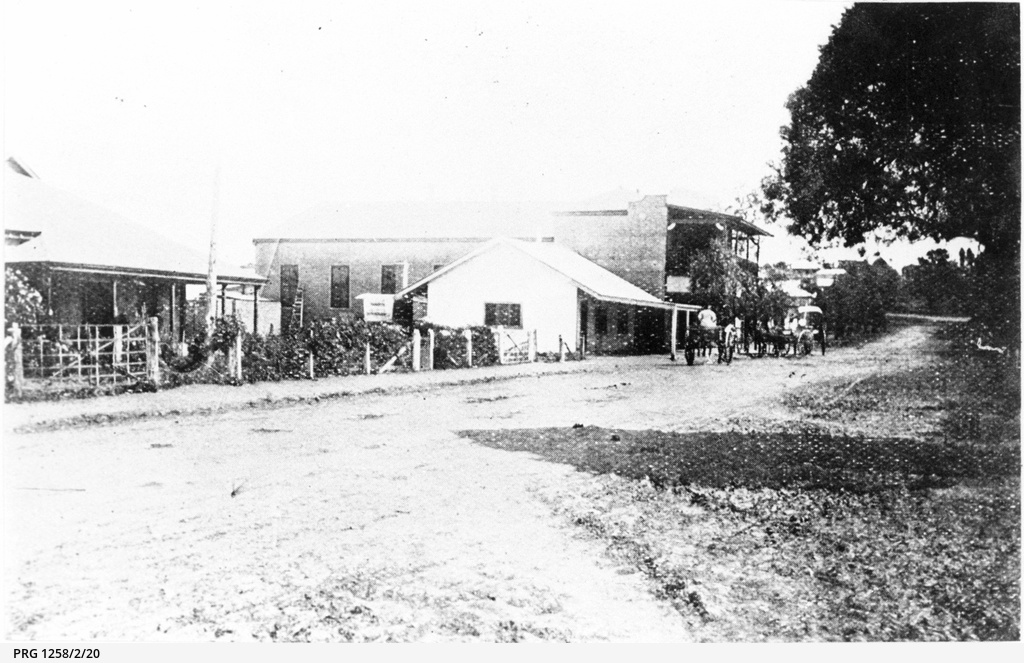 Early view of Berri buildings with dirt road