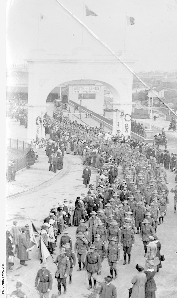 Soldiers marching through the Anzac Arch, Adelaide