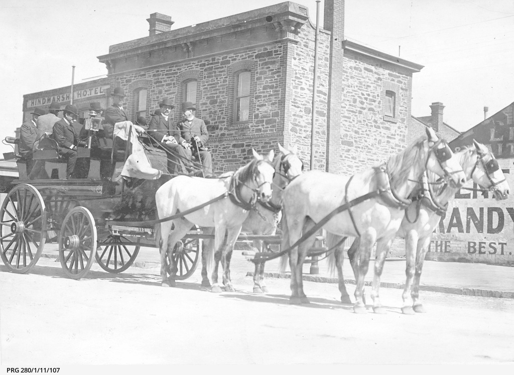 Horse drawn vehicle passing the Hindmarsh Hotel on Labor Day in Adelaide, South Australia