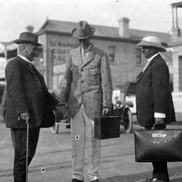 Sir Douglas Mawson with two men