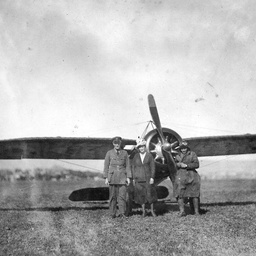 Captain Harry Butler standing in front of his aircraft