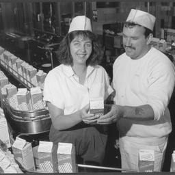 Photograph shows Angi Winkley, who will represent SA Rural Youth in the United Kingdom for six months with Jerry Griffiths, of Salisbury East, on the milk packaging line at Farmers Union Foods Mile End Plant. Farmers Union is sponsoring Angi and gave her a  week long briefing on the Dairy Industry, from farm to home delivery of products. 4th April 1990
