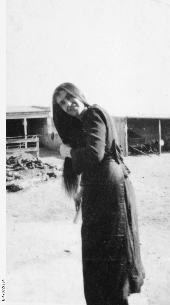 A young woman combing her hair