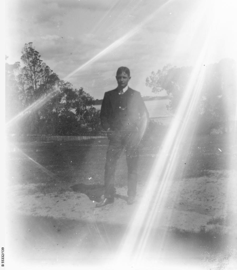 Boy posing in rural landscape