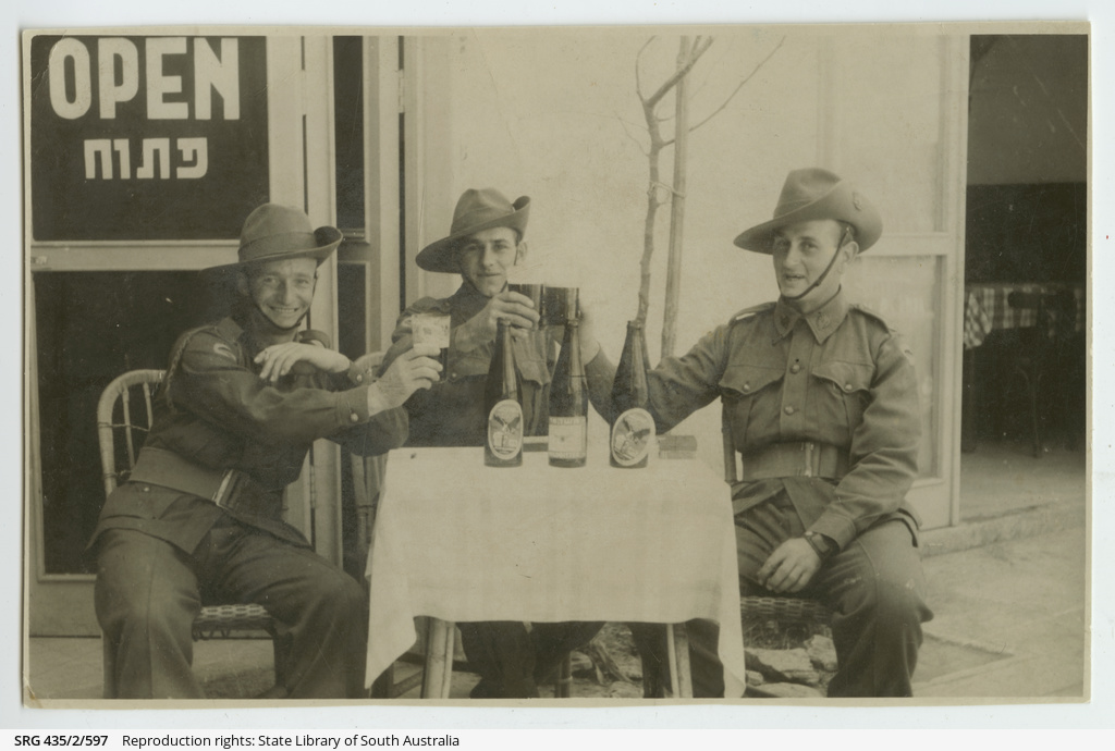 Soldiers enjoying a drink at Tel Aviv.