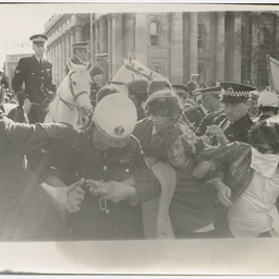 Police trying to hold back protesters at the Vietnam War Moratorium rally