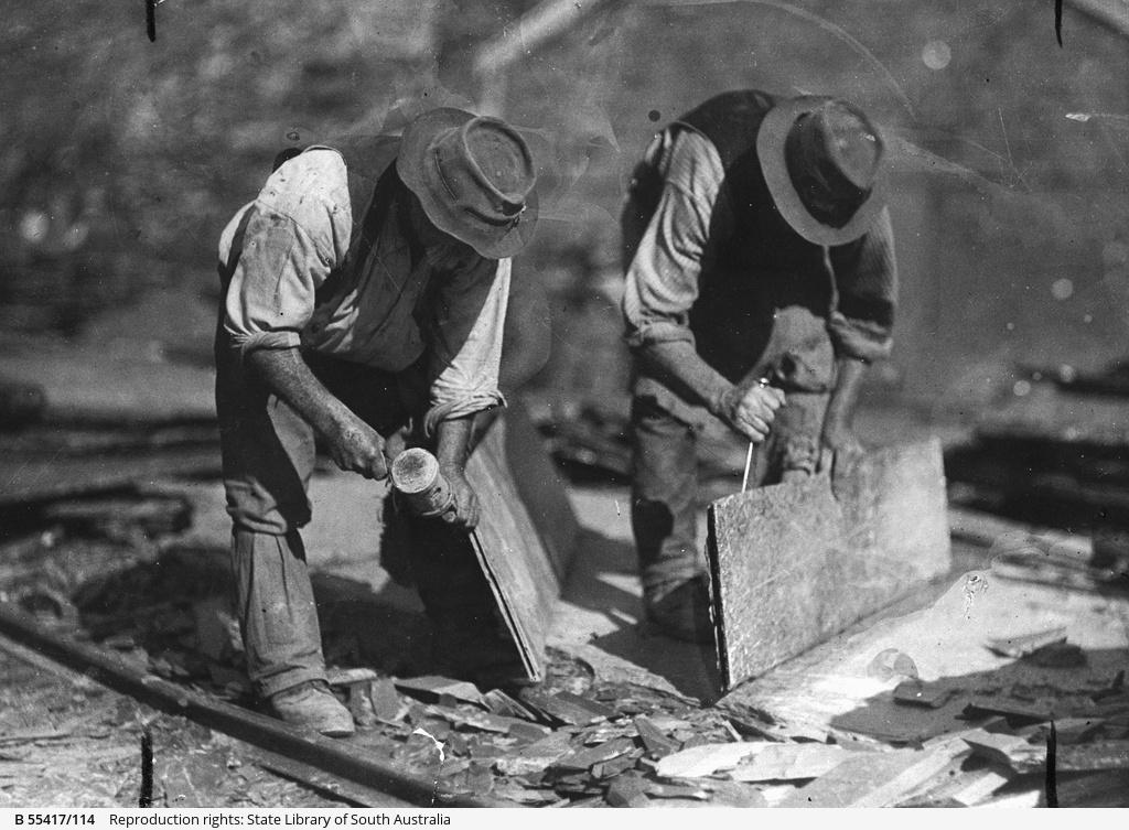 Demonstration of splitting slate for roofing