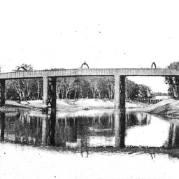 The railway bridge at Echuca with wharf in distance