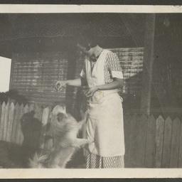Maud Williams feeding dog