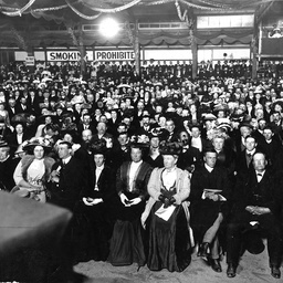 A packed audience at a meeting in a large hall in South Australia