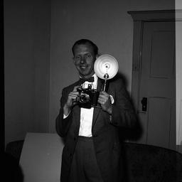 Vic Grimmett holding a camera