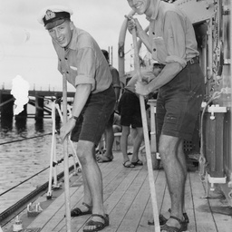 Two cadets swabbing the deck