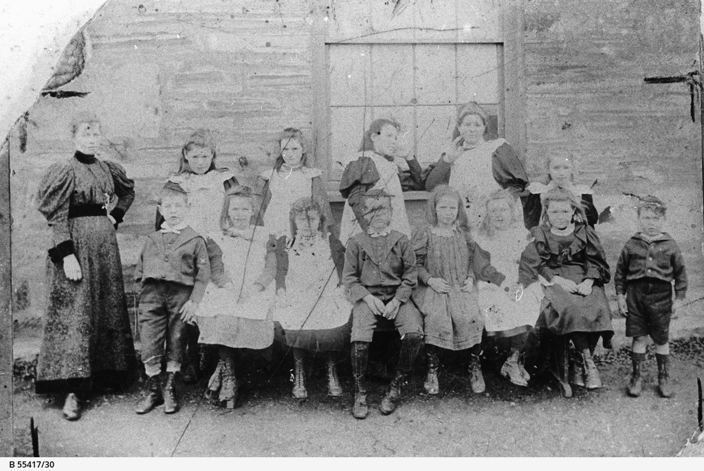 Miss Hawkins a teacher at Bassetts Private School with her students