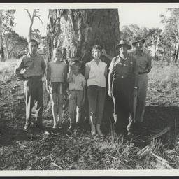 Group in front of canoe tree