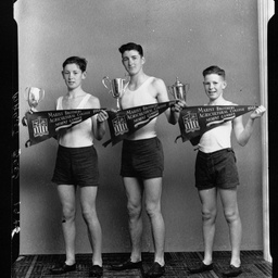 Schoolboy athletes with trophies