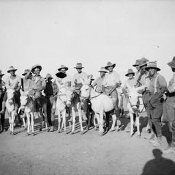 Men riding donkeys.