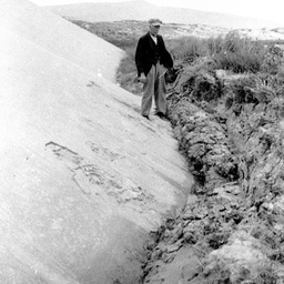 George Ross standing on edge of sand drift at Younghusband Peninsula